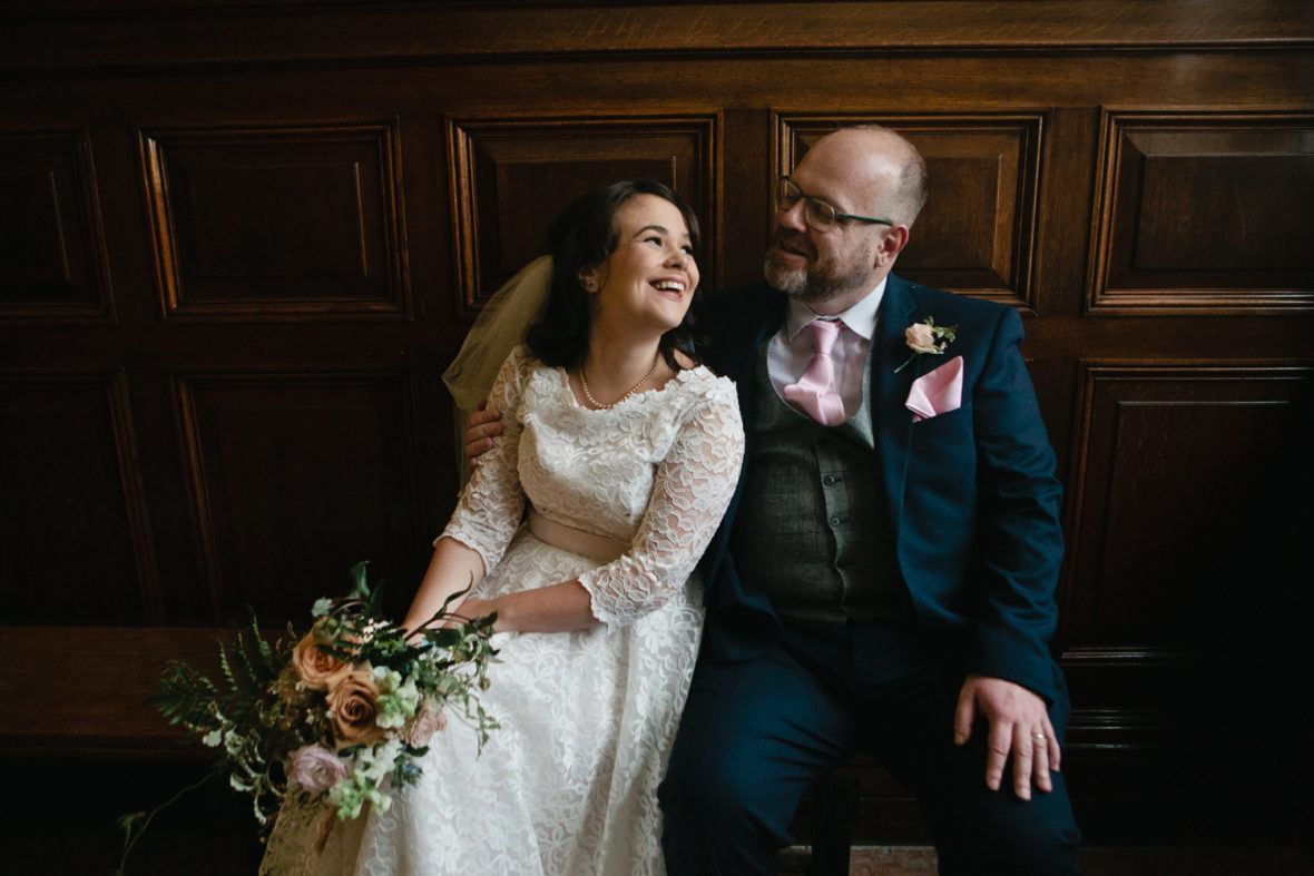 A happy laughing bride and groom at their winter west london wedding photographed by Matilda Delves London wedding photographer