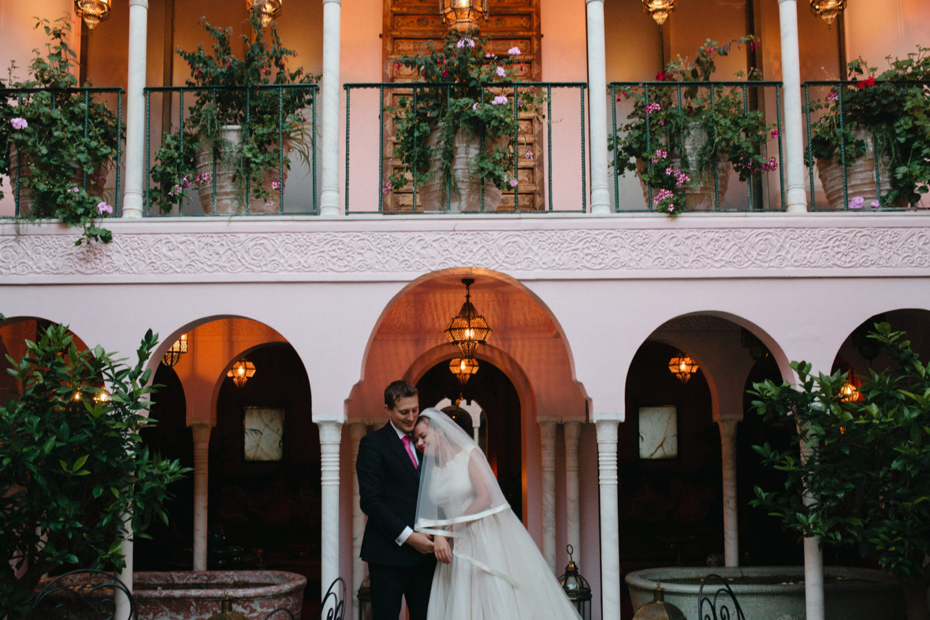 A bride and groom in the morrocan courtyard at Port Lympne wedding venue