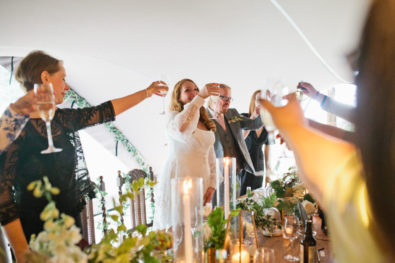 A bride doing a toast during the speeches at The Oak Grove wedding venue in North Kent
