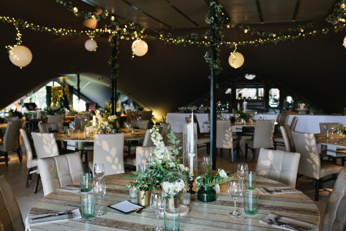 A table setting in a safari marquee for a wedding breakfast