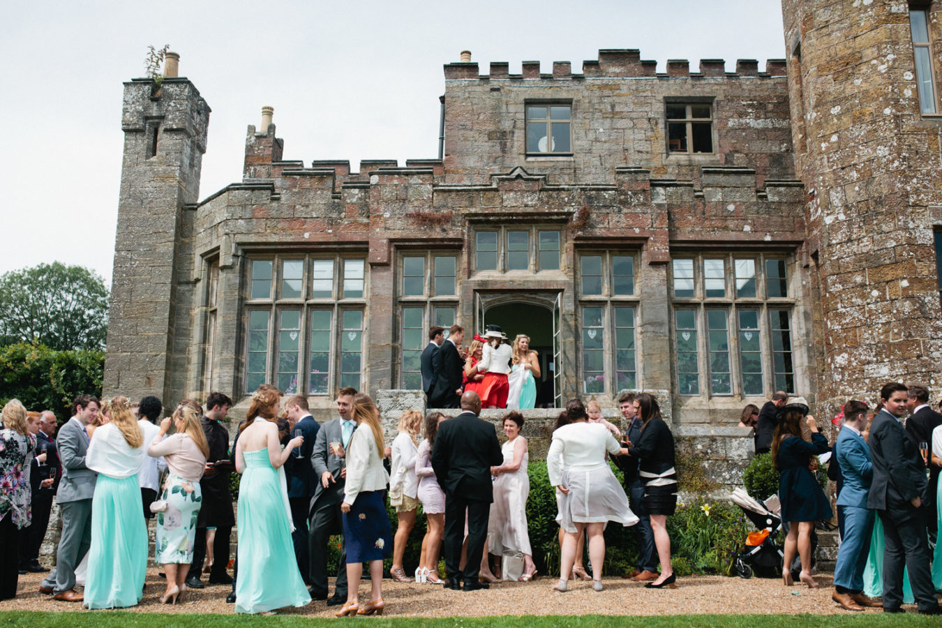 Wedding guests on the steps at a Wadhurst Castle wedding