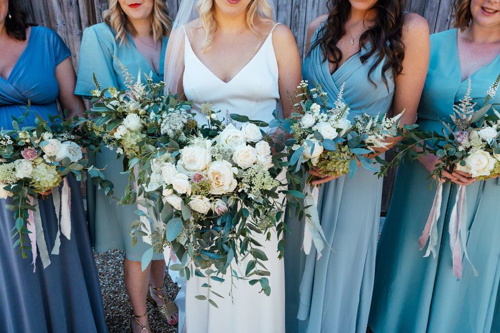 Bridesmaids in pastel coloured dresses at The Oak Barn in Benenden