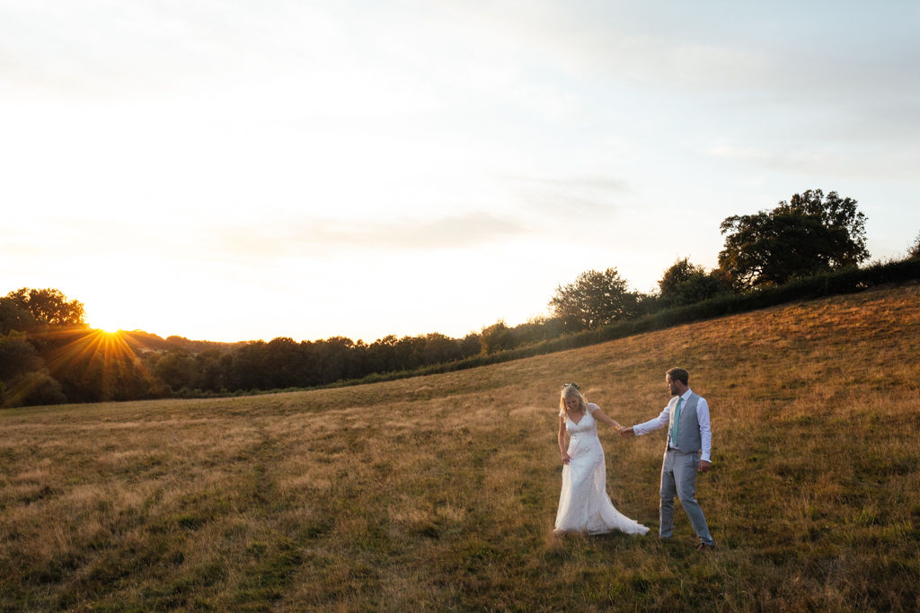 A bride and groom during a golden hour photo session at The Oak Barn Frame Farm Benenden Wedding