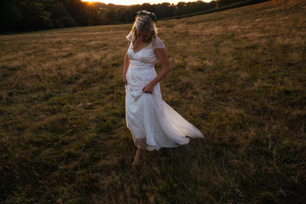 A bride wearing an Anna Campbell sequin dress at her The Oak Barn Frame Farm Benenden Wedding