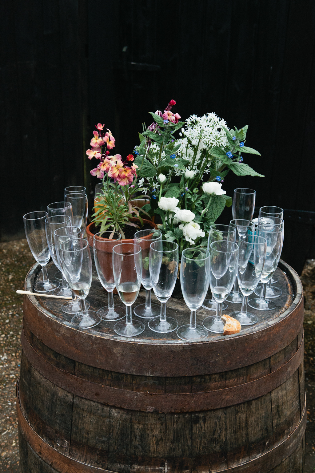 an old barrel being used as a table at a bran wedding in kent