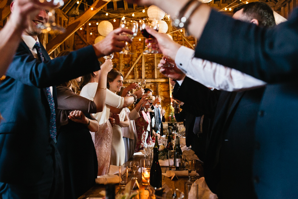 A view of the toast during the speeches at a barn wedding in Kent