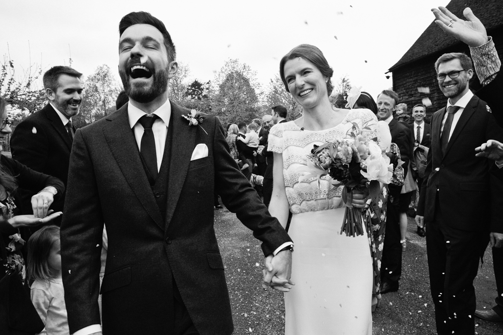 A balck and white portrait of a bride and groom at their the great barn rolvenden wedding photographed by London documentary wedding photographer Matilda Delves