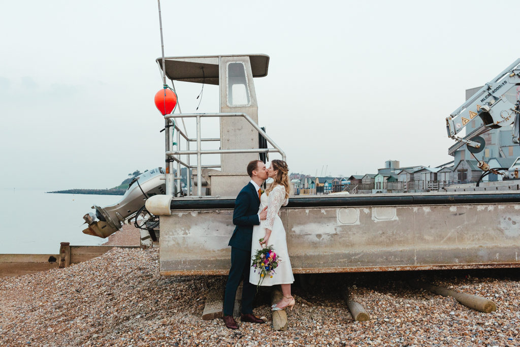 a bide and grrom kissing at the east quay wedding venue in Whitstable