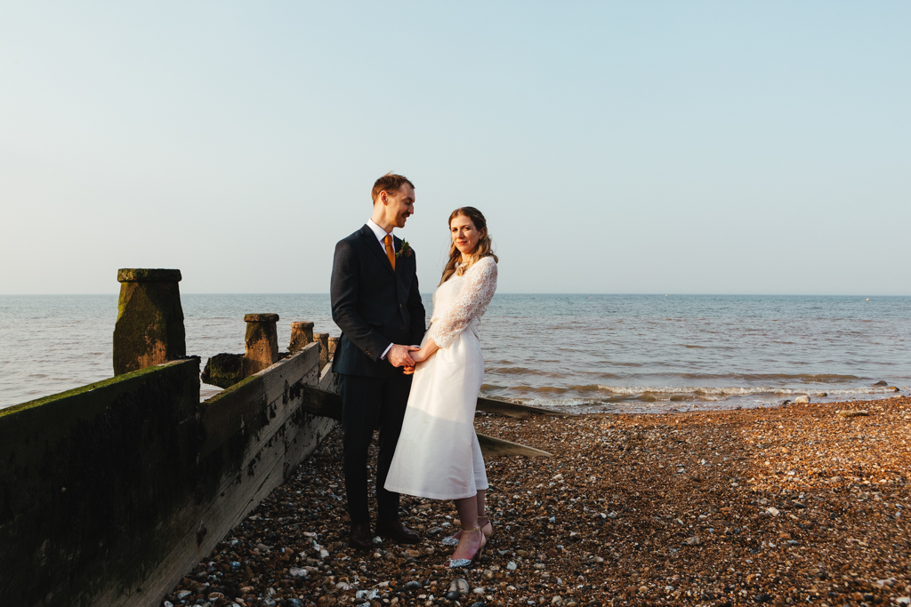 A bride and groom at their seaside wedding in Whitstable