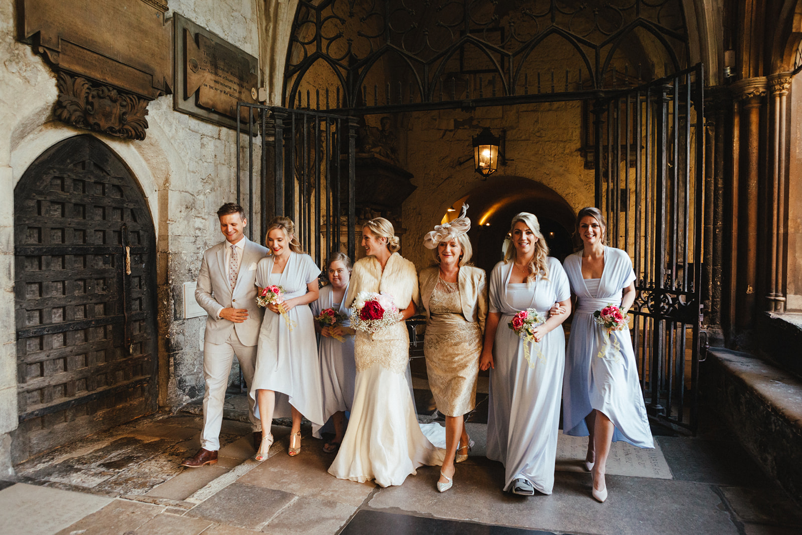 A bride walks into Westminster Abbey wedding with her bridal party