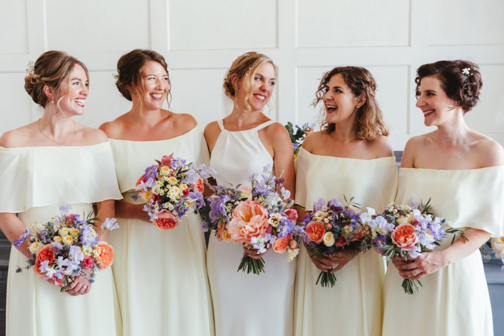A bride and her bridesmaids with flowers by Wild Rubus wedding florist