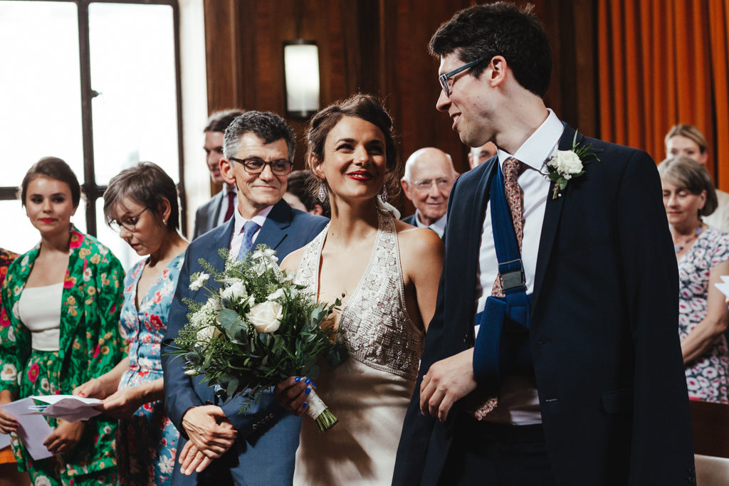 A bride and groom having just walked down the aisle at a Stoke Newington Town Hall Wedding