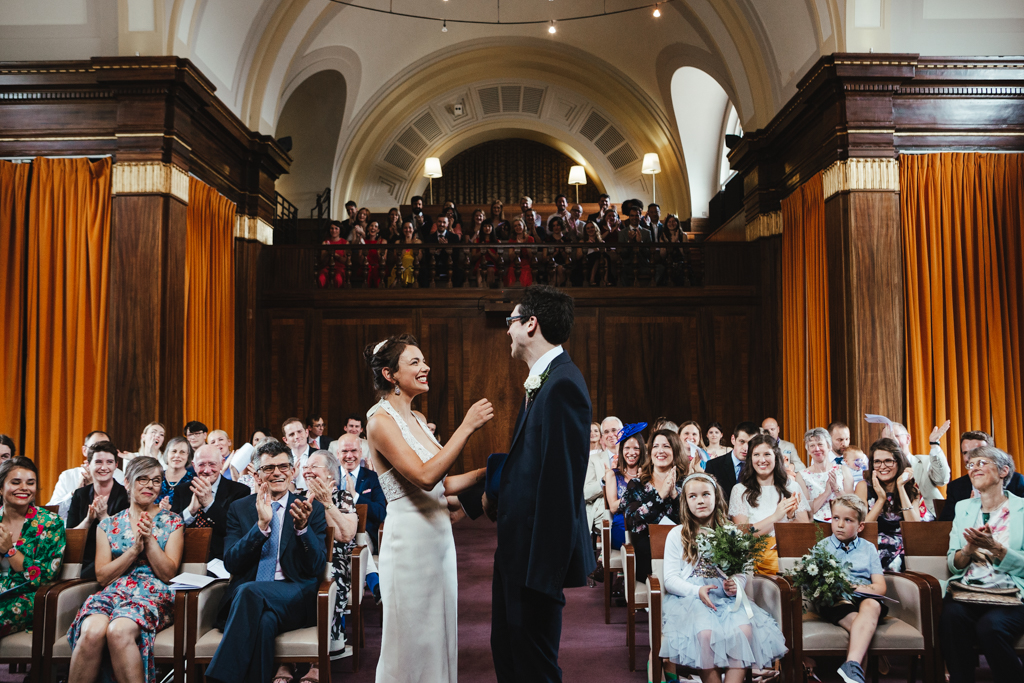 A bride and groom say their vows at a Stoke Newington Town Hall Wedding photographed by natural London Wedding Photographer Matilda Delves