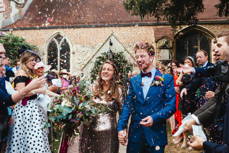 A photo of a bride in a gold sequin dress at her West London wedding photographed by natural London Wedding photographer Matilda Delves